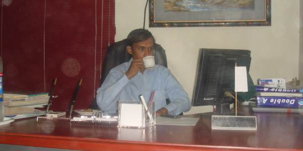 Muhammad Idrees -Principal in his office